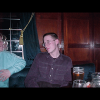 Tom gazes lovingly into Neil's eyes